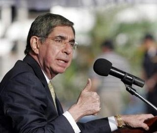 Costa Rica's President Oscar Arias speaking during the graduation of a newly formed tourist police division in San Jose, Costa Rica, Wednesday, Dec. 20, 2006. The same day Arias announced that he will give his yearly salary to the poor.(AP Photo/ Kent Gilbert)