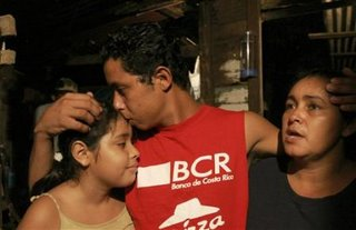 Costa Rican fisherman Roger Quintero, 15, embraces his sister Juana Mercados, 10, left, and his mother Mercedes Mercados, right, while speaking to the Associated Press about the 6 weeks he was adrift at sea in his home in Coco Beach, Costa Rica, on the northern Pacific coast, Thursday, Jan. (AP/Kent Gilbert)