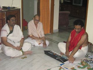 Sri Sameerana Chincholi (left) giving a discourse on Bhagavatha