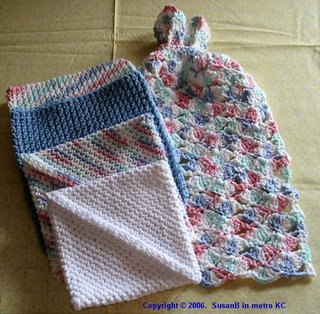 crocheted potholders and kitchen towel