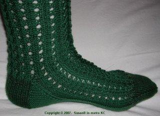 foot of green knee sock