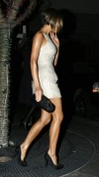 Victoria Beckham Shows Off Her Legs