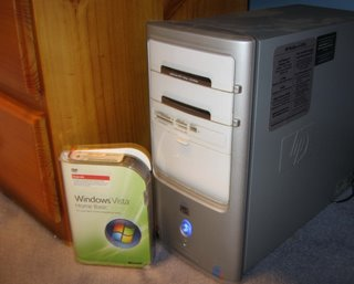 Windows Vista Home Basic kit next to HP Pavilion desktop computer