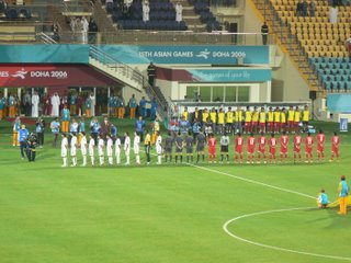The teams line up before the match