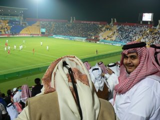 Qataris celebrate after their teams first goal