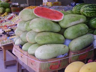 Huge and juicy watermelons piled high at the Omani market