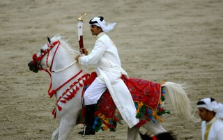 The Asian Games Torch being carried at a gallop across Bahrain