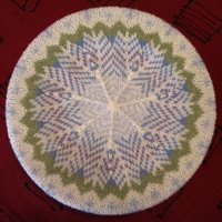 Top of Snowflakes Tam blocking on a dinner plate