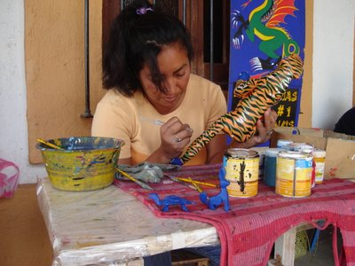Pale Horse Galleries for Mexican arts and crafts. http//palehorsemex.vstore.ca/ Josefina Morales painting another creation, an alebrije leopard, by Zapotec wood carver Oscar Carrillo.