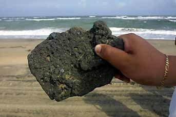 For gifts, collectibles and Mexican art and crafts, visit Pale Horse Galleries online store. http://palehorsemex.vstore.ca/ A worker holds up a piece of asphalt collected from a Tabasco beach which PEMEX claims is naturally occurring.
