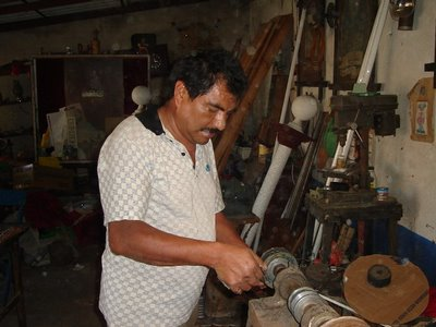 Mark in Mexico, http://markinmexico.blogspot.com/ Pale Horse Galleries for gifts, collectibles, Mexican arts and crafts, http://palehorsemex.vstore.com/ palehorsemex.blogspot.com/ Angel Aguilar pictured polishing a hand forged and tempered knife blade in Ocotlan, Oaxaca, Mexico.