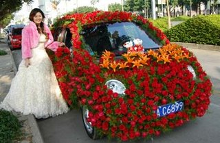 Flower Covered wedding Car
