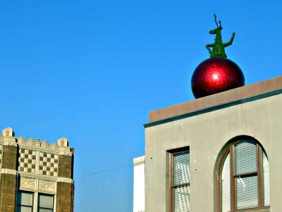 Up on the rooftop in Old Pasadena - green reindeer on a giant ornament