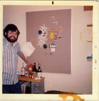 David Ocker in 1973 with his found-objects wall sculpture and his liquor collection