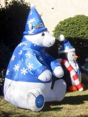 inflatable polar bear and penguin with snowflake caps