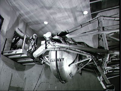 Astronaut Walter M. Schirra Jr. prepares to enter gondola of centrifuge which is used to test gravitational stress on astronauts training for space flight. Schirra became the pilot of the Mercury-Atlas 8 six-orbit space mission. Credit: NASA Johnson Space Center (NASA-JSC)