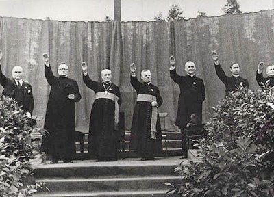 Priests giving the Hitler salute at a Catholic youth rally in the Berlin-Neukölln stadium in August 1933