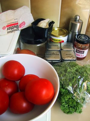 Selection of ingredients to make tomato soup, arranged on a counter.