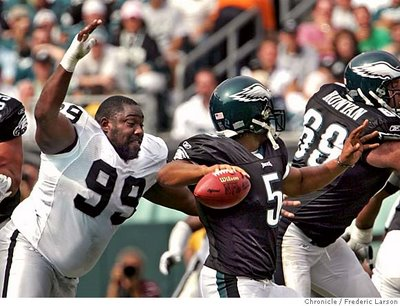 Warren Sapp tries to eat Donovan Mcnabb