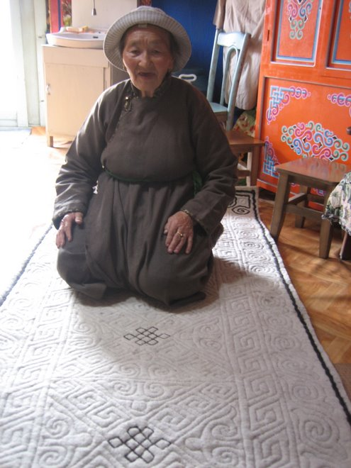 Naran's Grandma and the rug she made