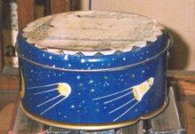 Russian biscuit tin (1959) featuring early spacecraft