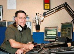 Bill Clark on a radio