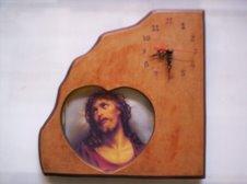 Reloj y portaretrato tallado en madera