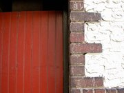 Red Door Brick and Stucco Wall