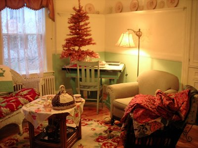 Cate's tea room with new pink tinsel tree - see the pile of fabric in the chair on the right? She was showing me her stash