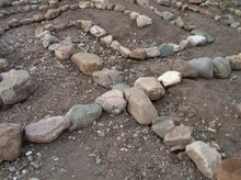 cross in labyrinth builded with stones out xeros river