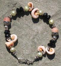 Black Onyx, Pearl, Orange Jade, and Seashell