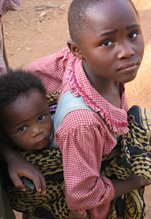 A young Rwandan mother and her child.