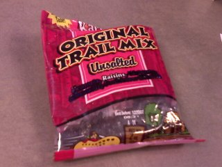 Trailmix bag that has ingredients crossed out so that only 'raisins' appears