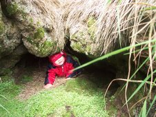 Esther crawling through an old doorway