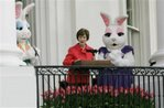 First lady Laura Bush, flanked by Easter bunnies during the annual White House Easter