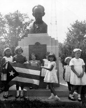 Cuban children in Shively with the Flag of Cuba