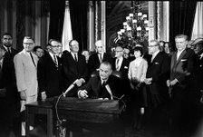 LBJ signing one of the Civil Rights Bills of the 1960s.