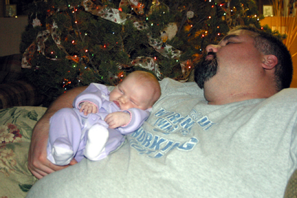 Snoozing with daddy.