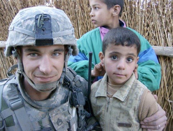 SSG Hager with Iraqi child
