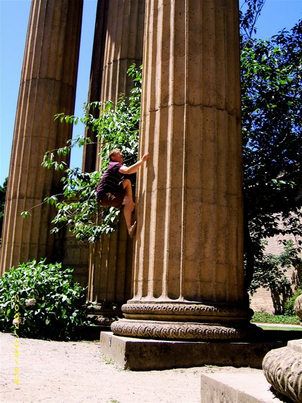 Joel climbing the pillars