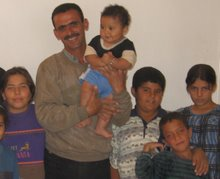 Thaer with Refugee Children