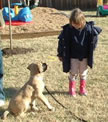Kayleigh helps teach a pup manners