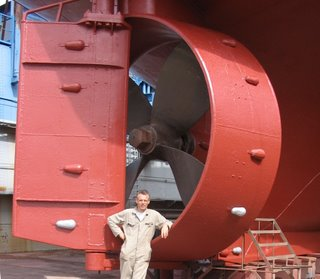 that's me at the prop of a sister ship.  Big props have a higher efficiency