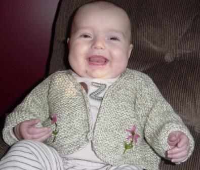 Smiling Kalen in her sweater