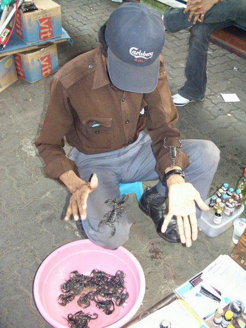 Itinerant Scorpion Seller, Pasar Minggu Station platform, East Jakarta