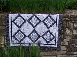licorice twist redwork quilt- 6 pattern blocks and quilt layout.