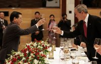 President George W. Bush exchanges toasts with Viet President Nguyen Minh Triet during a State Banquet Friday, Nov. 17, 2006, at the International Convention Center in Hanoi. President Bush told his host, 'Vietnam is a country that's taking its rightful place as a strong and vibrant nation,' adding he hoped its people know they have the friendship of the American people. White House photo by Paul Morse.
