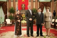President George W. Bush and Mrs. Laura Bush join Viet President Nguyen Minh Triet and Mrs. Tran Thi Kim Chi in the Great Hall of the Presidential Palace Friday, Nov. 17, 2006, after arriving in Hanoi for the 2006 APEC Summit. White House photo by Eric Draper.