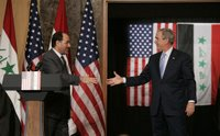 President George W. Bush reaches out to Iraqi Prime Minister Nouri al-Maliki Thursday, Nov. 30, 2006, following a joint press availability in Amman, Jordan. White House photo by Paul Morse.