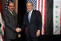 President George W. Bush and Prime Minister Nouri al-Maliki shake hands after a joint press availability Thursday, Nov. 30, 2006, in Amman, Jordan. The leaders later issued a joint statement in which they said they were, 'Pleased to continue our consultations on building security and stability in Iraq.' White House photo by Paul Morse.